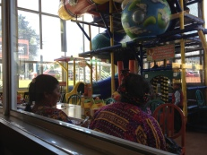 Mayan ladies taking their kids to Pollo Campero (the KFC of Guatemala)